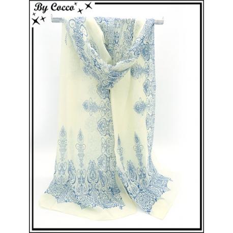 Mousseline - Fond jaune clair - Arabesques bleues
