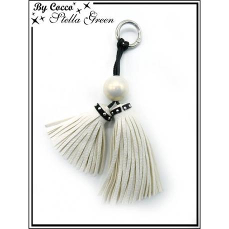 Bijoux de Sacs - Stella Green - Deux pompons - Une perle nacré - Blanc