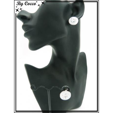 Boucles d'oreilles - Strass - Contour blanc / doré