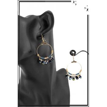 Boucle d'oreille - Forme ronde - Perles et pierres irisées